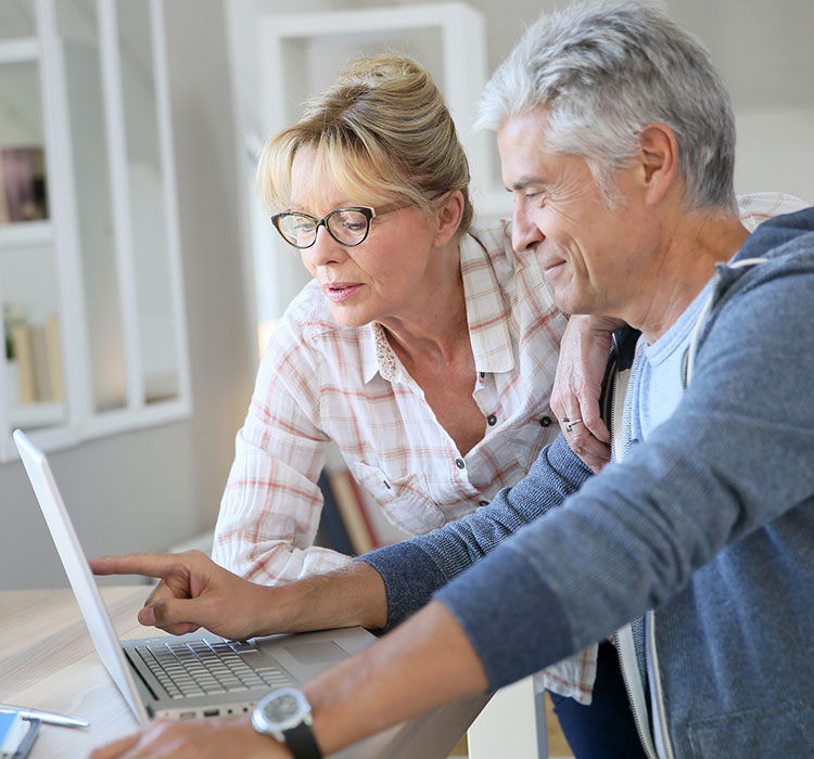 bigstock-Senior-couple-at-home-checking-102394388